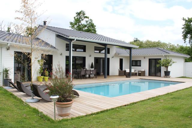 Une maison bois design et confortable for Maison bois design contemporain
