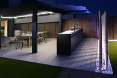 Una fantástica cocina de exterior con barbacoa y fogón paellero
