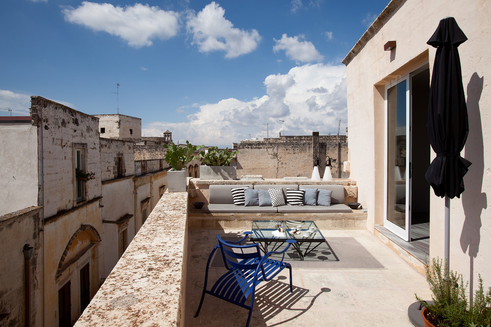 Inspiration for a mid-sized mediterranean rooftop rooftop deck remodel in Milan