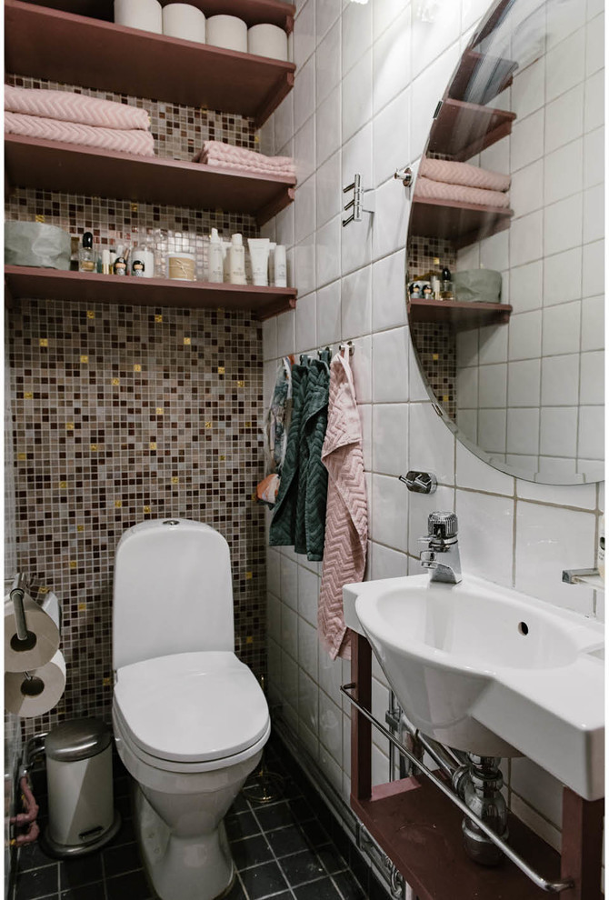 Inspiration for a small scandinavian mosaic tile, multicolored tile and white tile black floor powder room remodel in Stockholm with open cabinets, a one-piece toilet, a wall-mount sink and dark wood cabinets