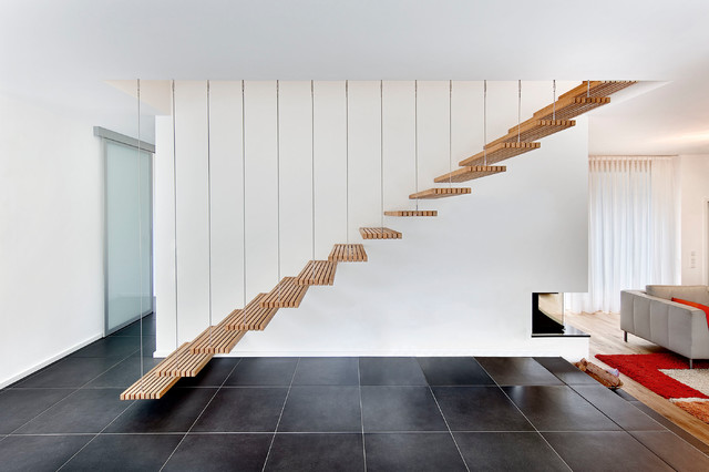 Staircase - mid-sized contemporary wooden floating open staircase idea in Stuttgart