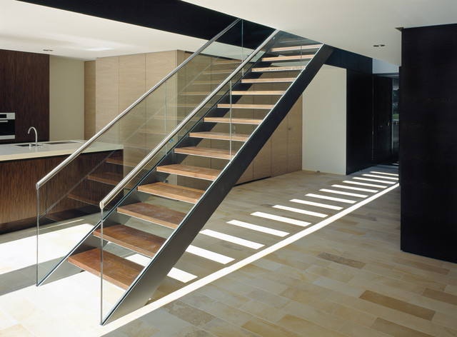 Mid-sized trendy wooden straight open and glass railing staircase photo in Other