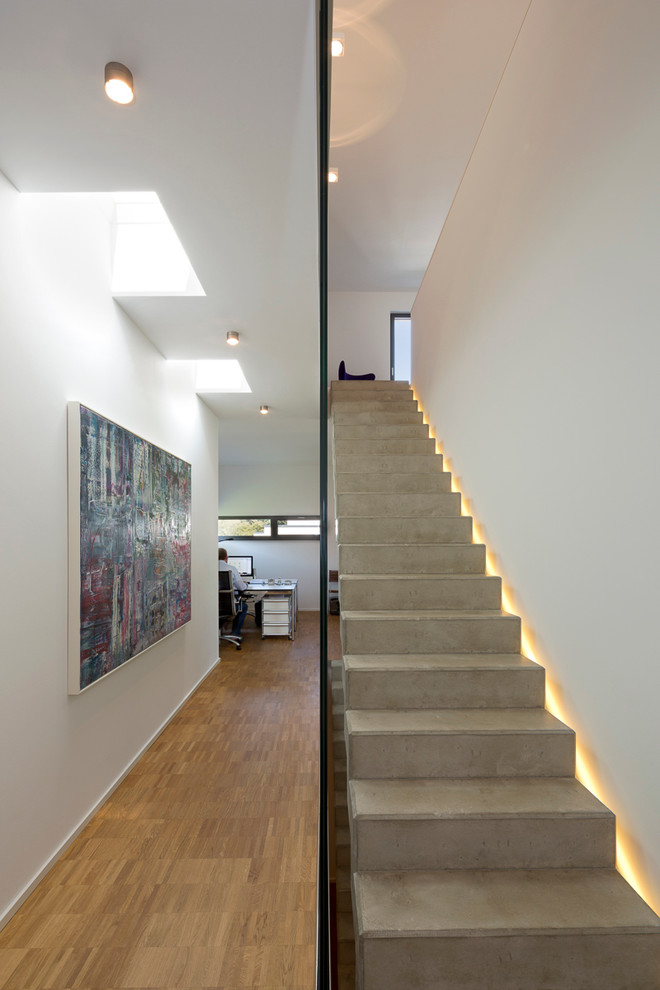 Staircase - mid-sized contemporary concrete straight staircase idea in Dortmund