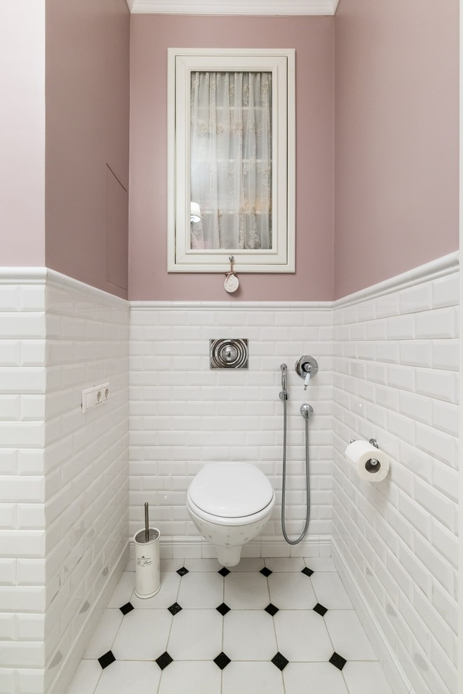 Inspiration for a timeless white tile and subway tile multicolored floor powder room remodel in Moscow with a wall-mount toilet and pink walls
