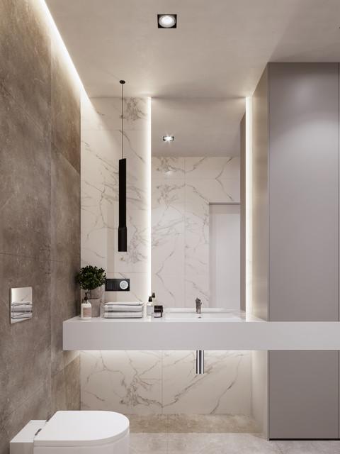 Ejemplo de aseo contemporáneo, pequeño, con sanitario de pared, baldosas y/o azulejos blancos, baldosas y/o azulejos de mármol, suelo de baldosas de porcelana, encimera de acrílico, suelo gris, encimeras blancas y lavabo integrado