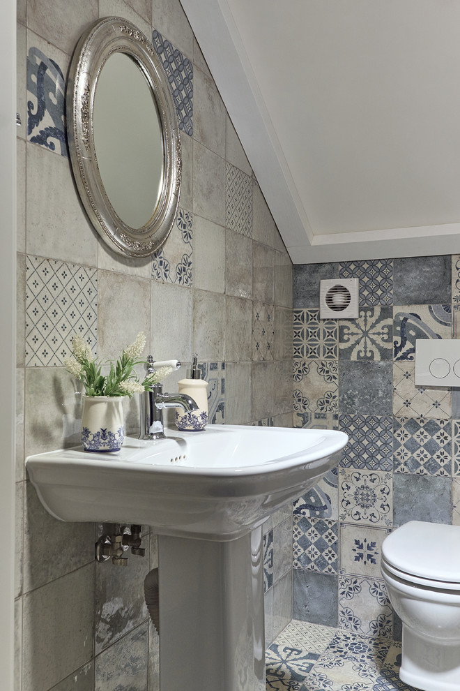Small cottage chic gray tile and blue tile multicolored floor powder room photo in Other with a pedestal sink and a one-piece toilet