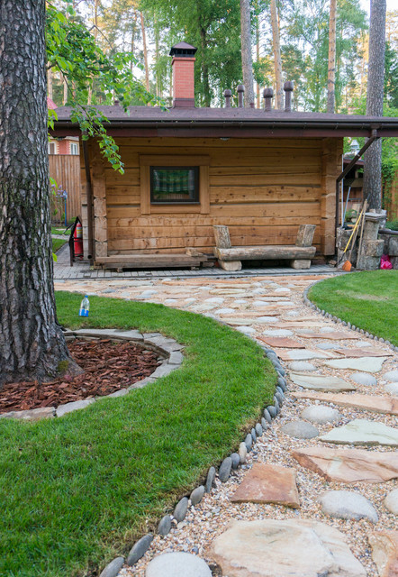 Inspiration for a rustic partial sun gravel garden path in Moscow for summer.