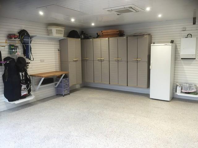 Extraordinary garage makeover by garageflex contemporary for Garage laundry room design