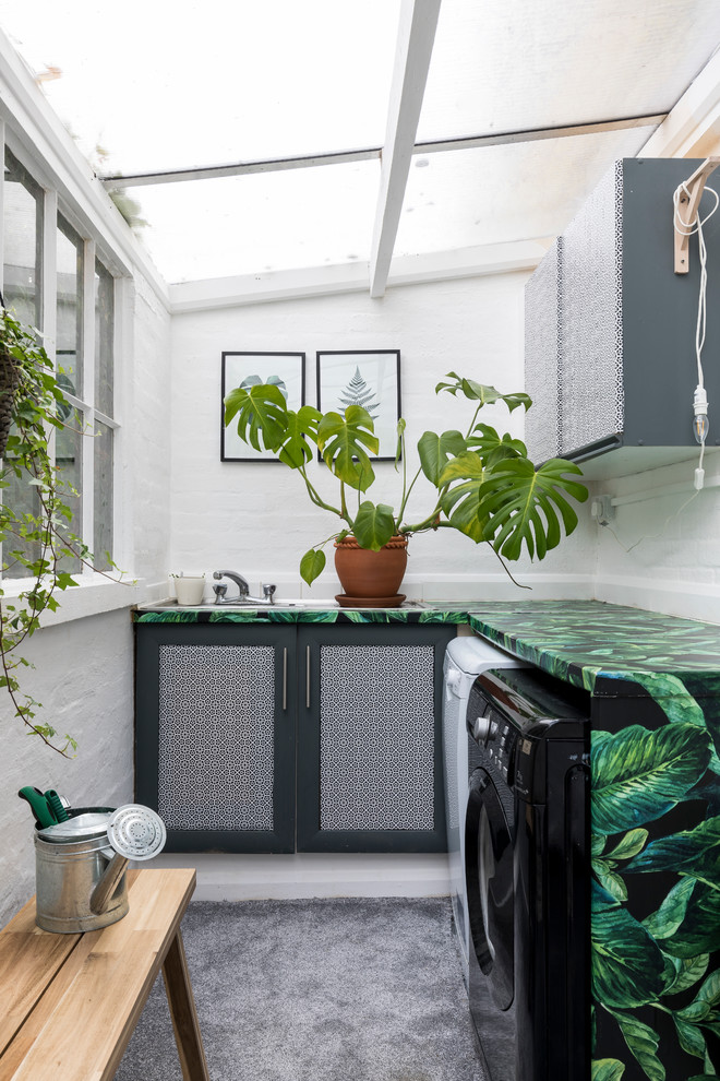 Eclectic l-shaped dedicated laundry room photo in London with shaker cabinets, white walls, a side-by-side washer/dryer and multicolored countertops
