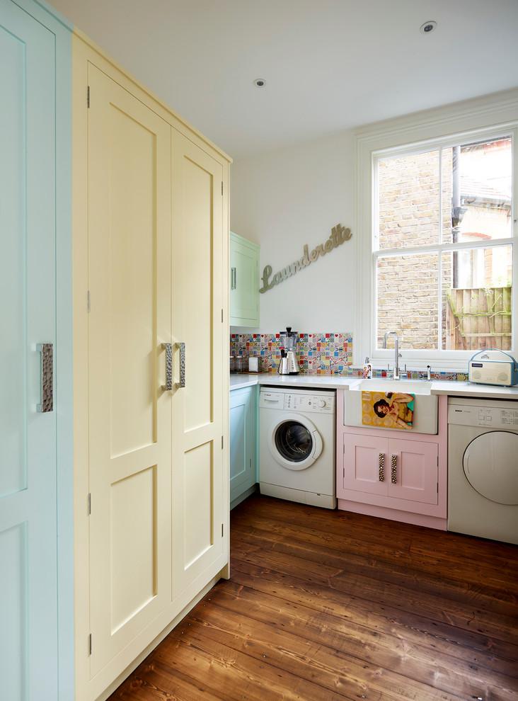 Elegant laundry room photo in London