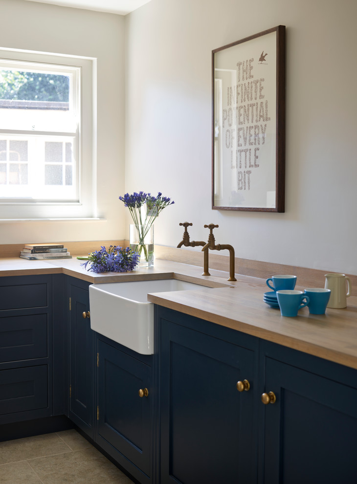 Laundry room - transitional laundry room idea in Sussex