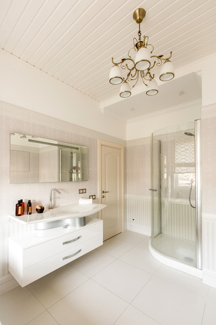 Inspiration for a large shabby-chic style master gray tile corner shower remodel in Other with flat-panel cabinets, white cabinets, a vessel sink and a hinged shower door
