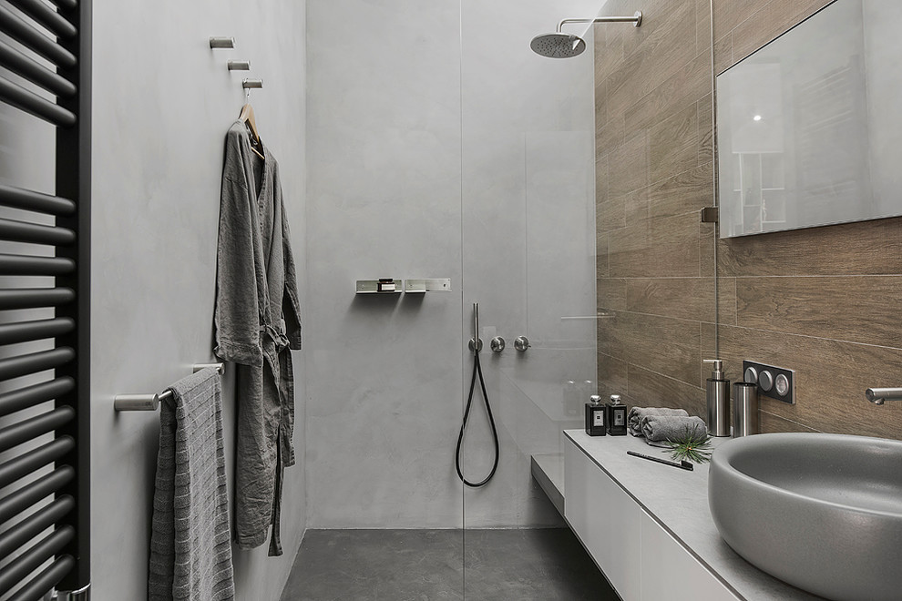 Inspiration for an industrial 3/4 brown tile bathroom remodel in Moscow with flat-panel cabinets, white cabinets, gray walls and a vessel sink
