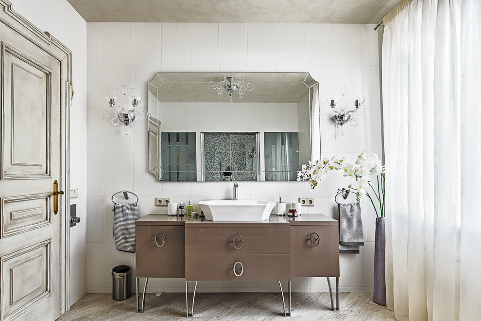 Inspiration for a timeless white tile bathroom remodel in Moscow with a vessel sink, furniture-like cabinets and brown cabinets