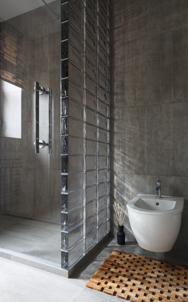Trendy 3/4 gray tile bathroom photo in Moscow with a wall-mount toilet and gray walls