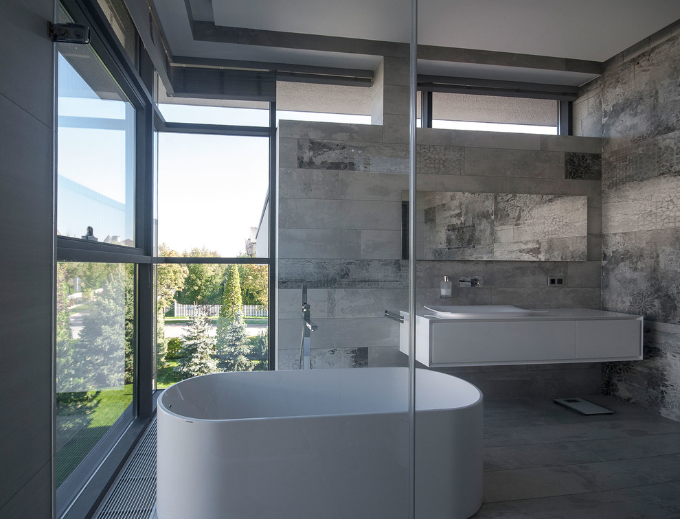 Inspiration for a contemporary master gray tile freestanding bathtub remodel in Moscow with flat-panel cabinets, white cabinets and a vessel sink