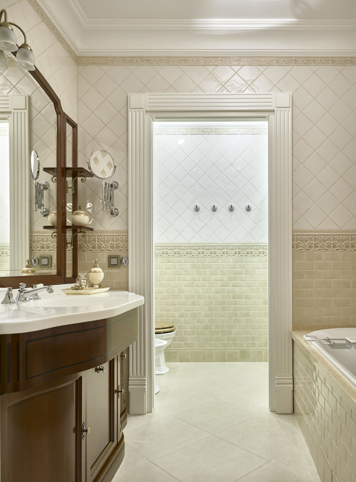 Example of a classic master beige tile, white tile and ceramic tile ceramic tile bathroom design in Moscow with recessed-panel cabinets, beige walls, dark wood cabinets and a two-piece toilet