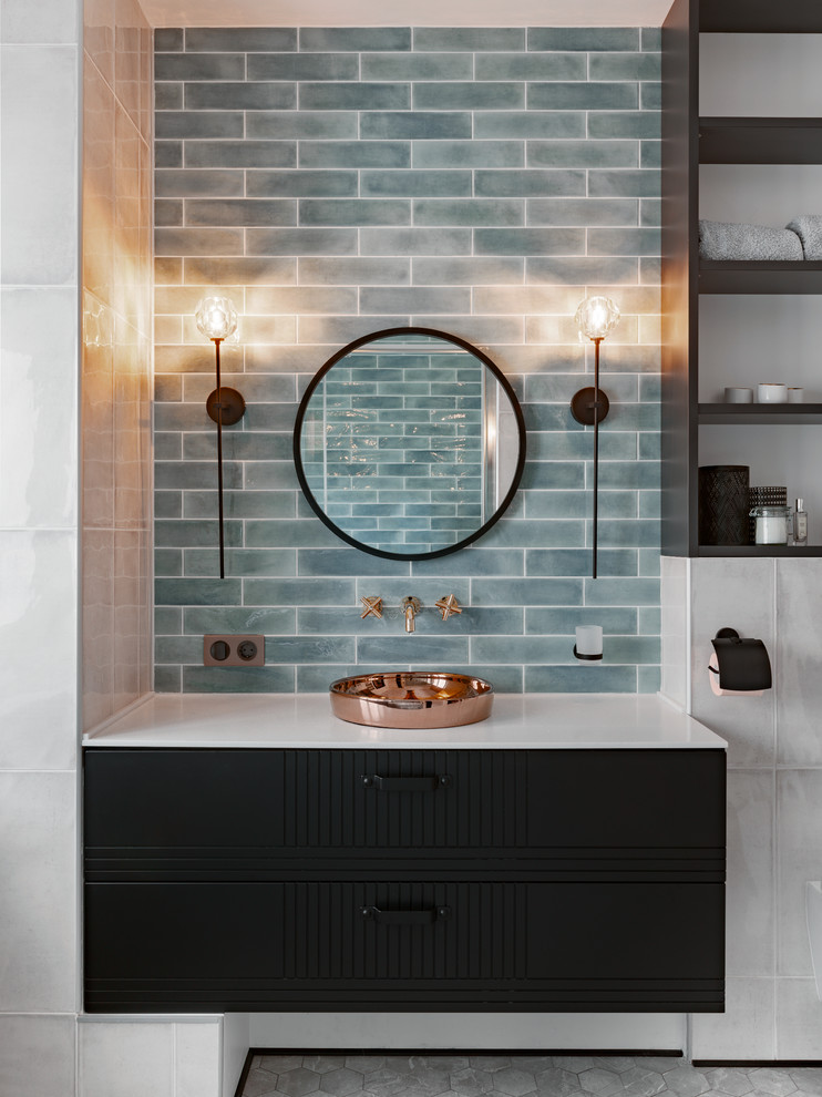 Contemporary bathroom in Other with black cabinets, blue tile, subway tile, blue walls, a vessel sink and grey floor.