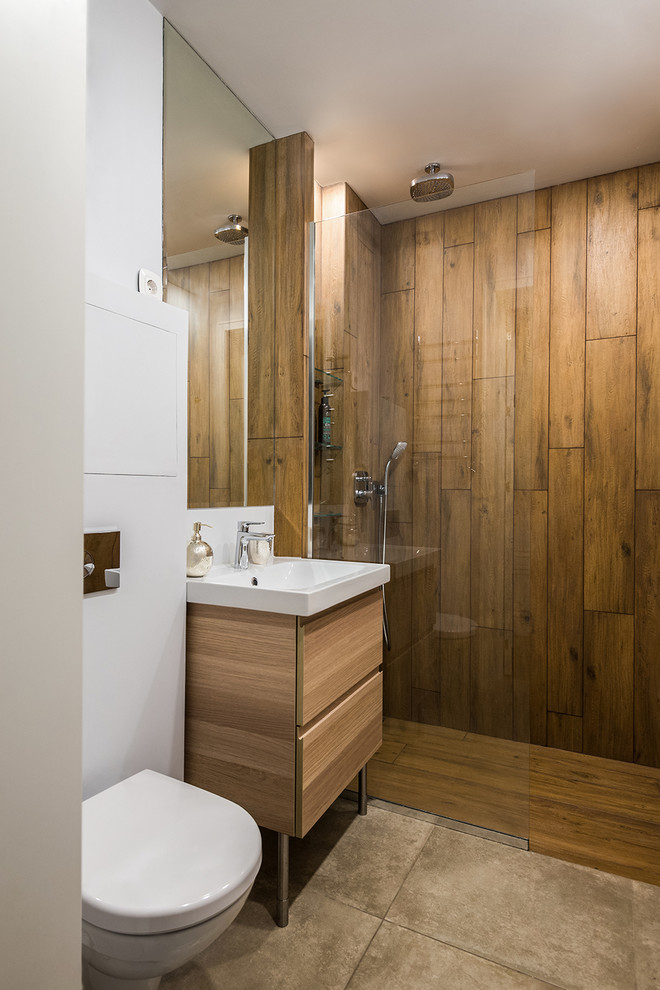 Trendy bathroom photo in Moscow with flat-panel cabinets, a wall-mount toilet, light wood cabinets and white walls