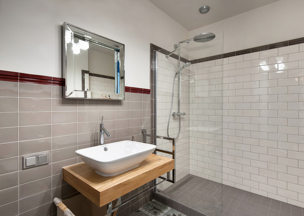 Inspiration for a mid-sized transitional 3/4 black tile, gray tile, multicolored tile, red tile, white tile and subway tile alcove shower remodel in Saint Petersburg with white walls, a vessel sink and wood countertops