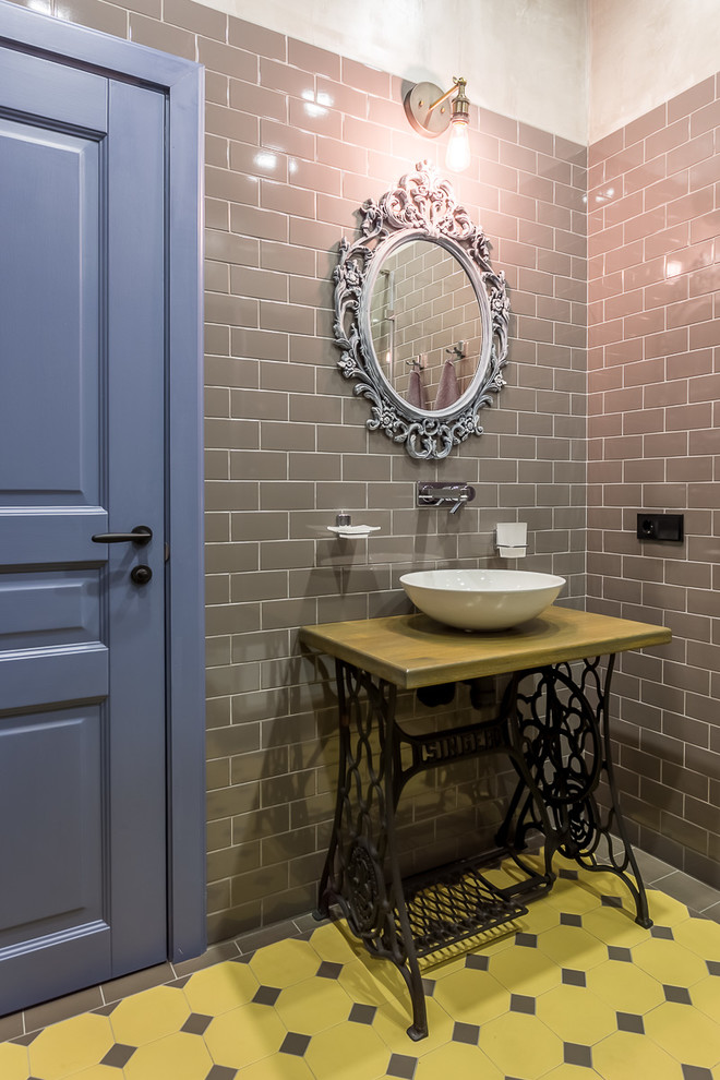 Bathroom - industrial yellow tile and gray tile bathroom idea in Moscow with gray walls and a vessel sink