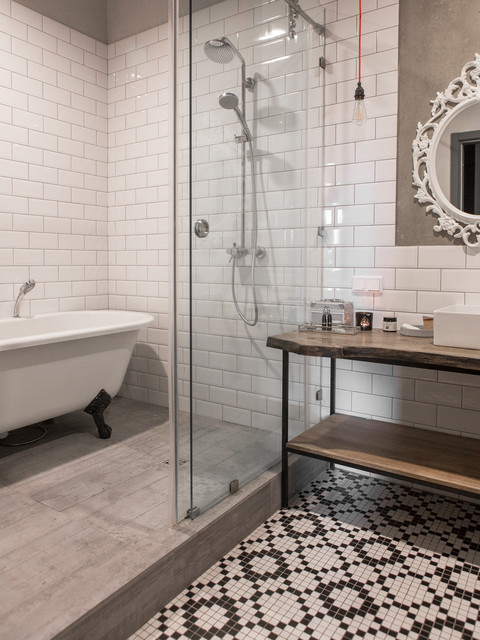 Industrial bathroom in Moscow with open cabinets, a claw-foot bath, white tiles, metro tiles, grey walls, a vessel sink, wooden worktops, mosaic tile flooring and a sliding door.