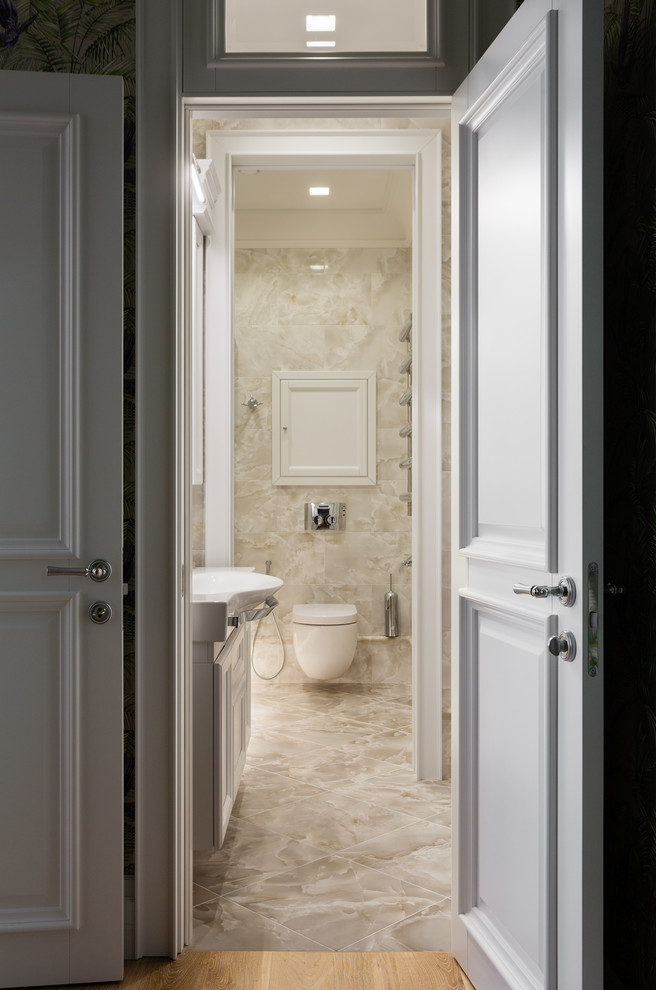 Small transitional beige tile and ceramic tile ceramic tile and beige floor bathroom photo in Moscow with white cabinets and a wall-mount toilet