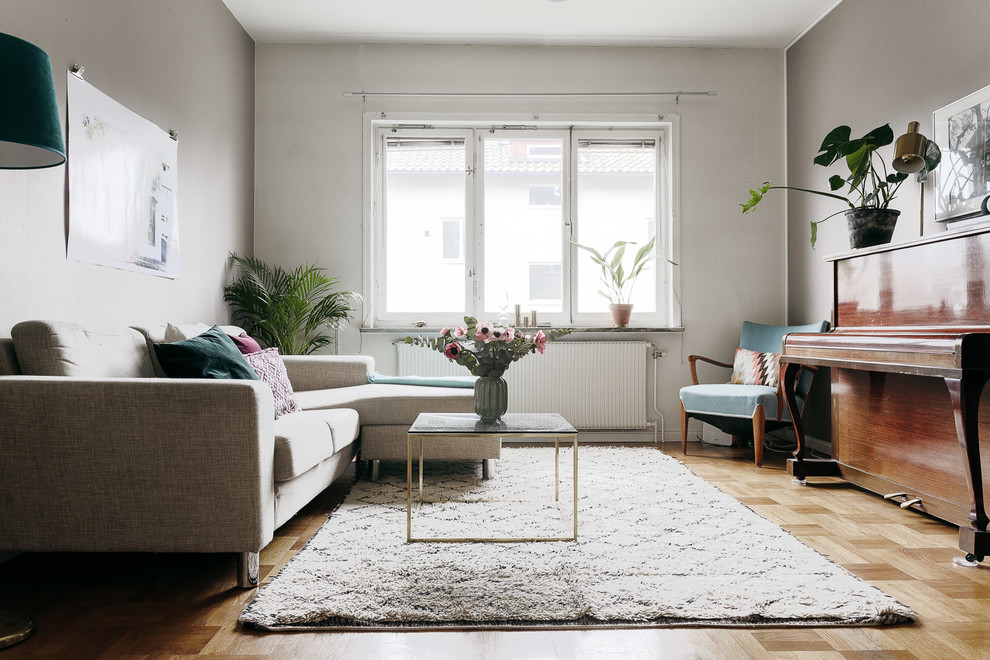 Danish enclosed light wood floor and beige floor living room photo in Stockholm with a music area and multicolored walls