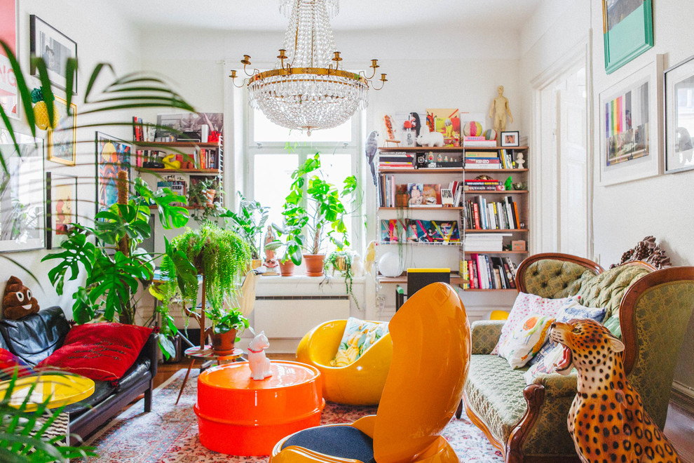 Example of a mid-sized eclectic formal light wood floor living room design in Stockholm with white walls
