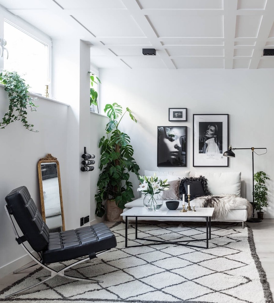 Mid-sized danish formal and open concept light wood floor living room photo in Stockholm with no tv, white walls and no fireplace