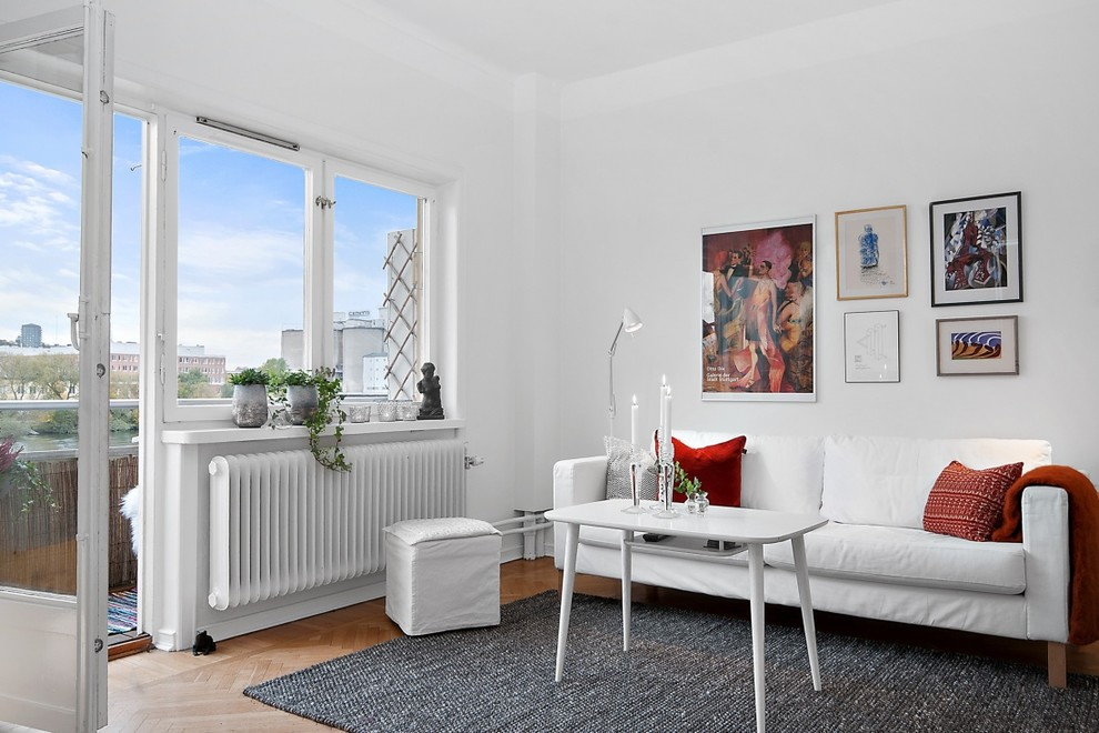 Mid-sized danish formal and open concept light wood floor living room photo in Stockholm with white walls, no fireplace and no tv