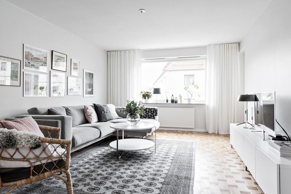 Living room - scandinavian enclosed light wood floor and beige floor living room idea in Gothenburg with white walls, no fireplace and a tv stand