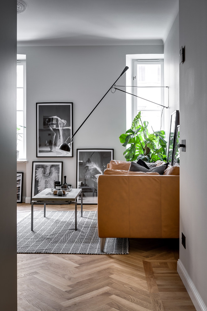 Inspiration for a mid-sized scandinavian living room remodel in Stockholm with gray walls