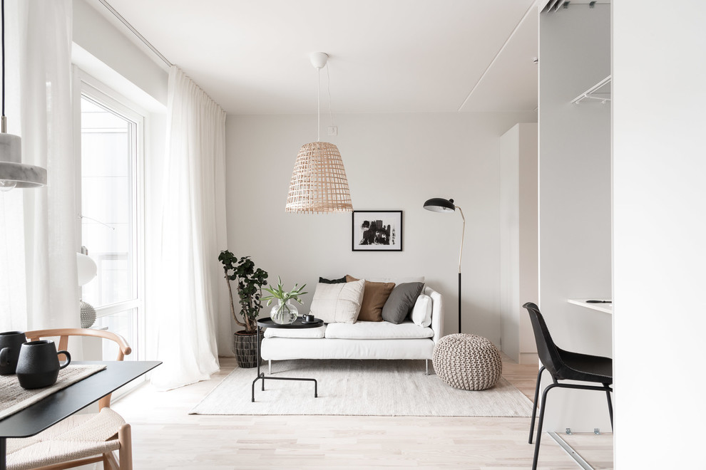 Living room - small scandinavian open concept light wood floor and beige floor living room idea in Gothenburg with white walls and no fireplace