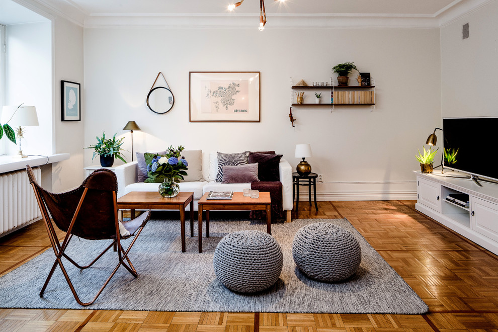 Living room - large scandinavian formal and open concept medium tone wood floor living room idea in Gothenburg with white walls, no fireplace and a tv stand