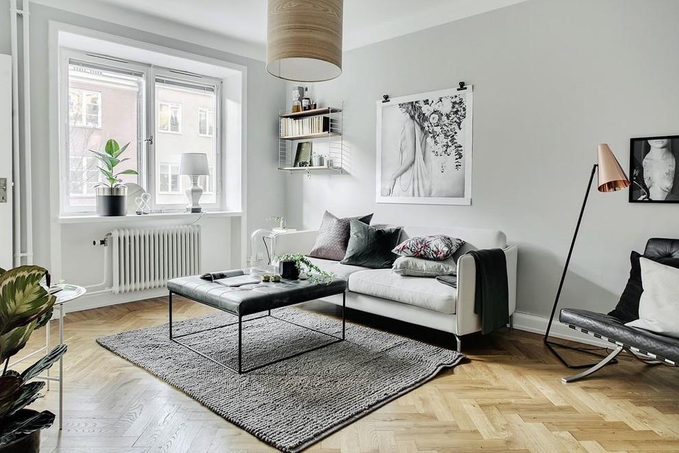 Living room - small scandinavian enclosed beige floor and light wood floor living room idea in Stockholm with gray walls