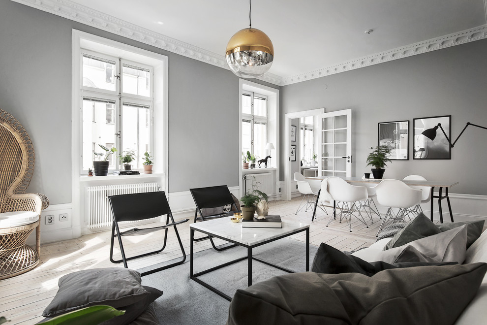 Large danish open concept and formal light wood floor living room photo in Stockholm with gray walls, no fireplace and no tv