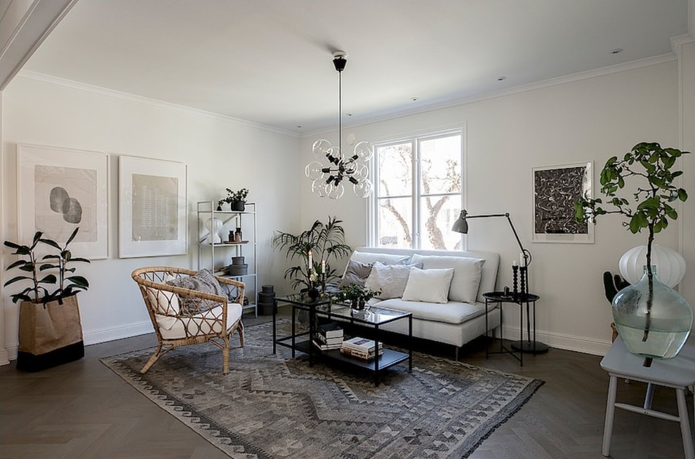Danish enclosed dark wood floor living room photo in Stockholm with white walls and no fireplace
