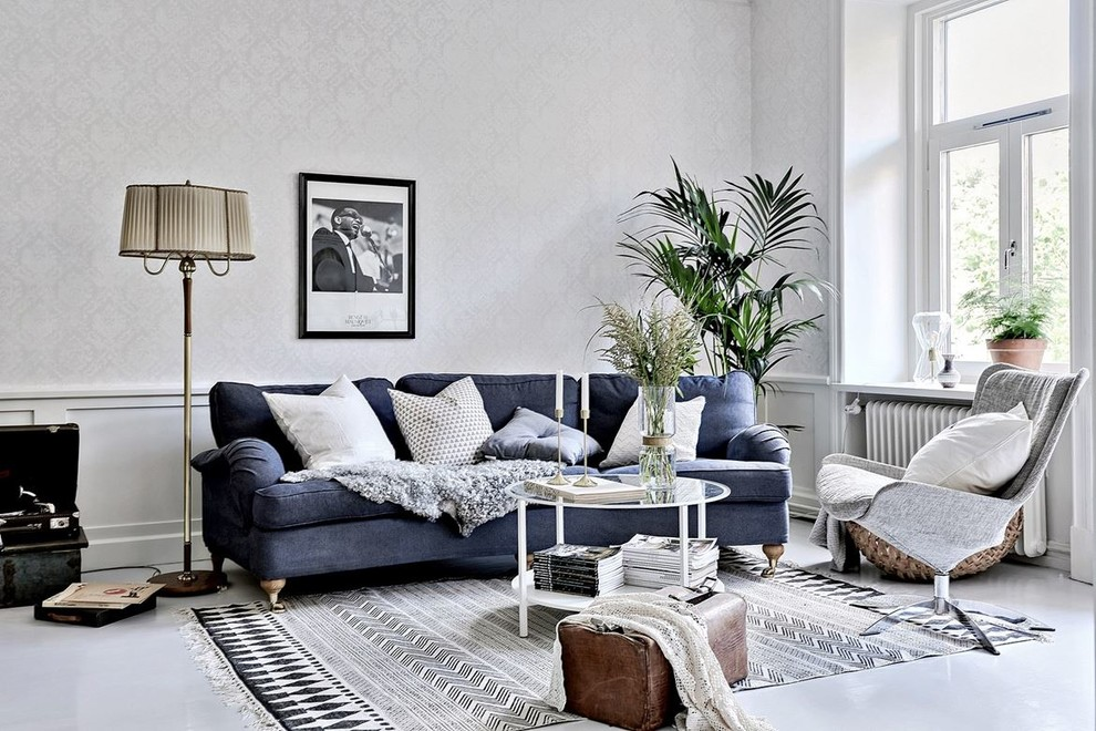 Inspiration for a mid-sized scandinavian formal and open concept concrete floor living room remodel in Gothenburg with gray walls and no tv