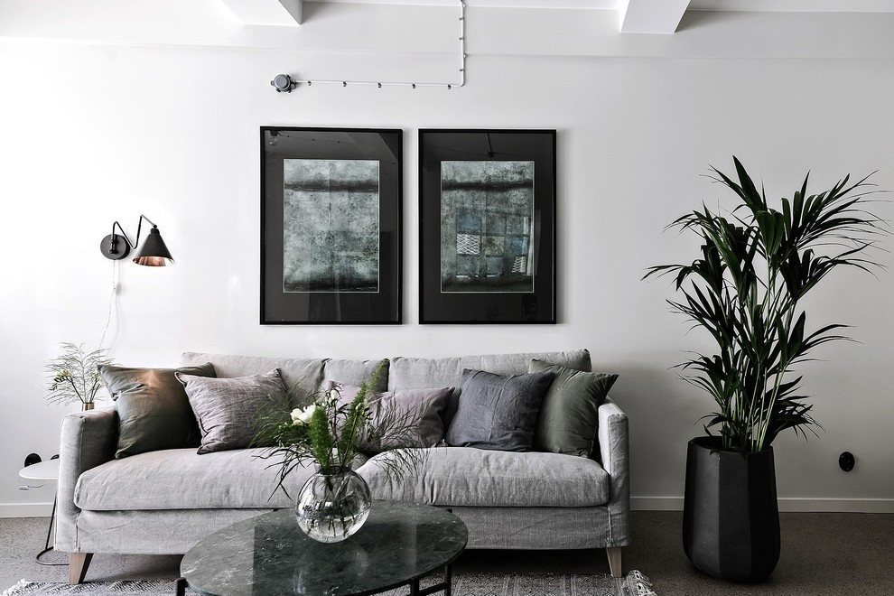 Inspiration for a scandinavian formal and open concept concrete floor living room remodel in Gothenburg with white walls, no fireplace and no tv