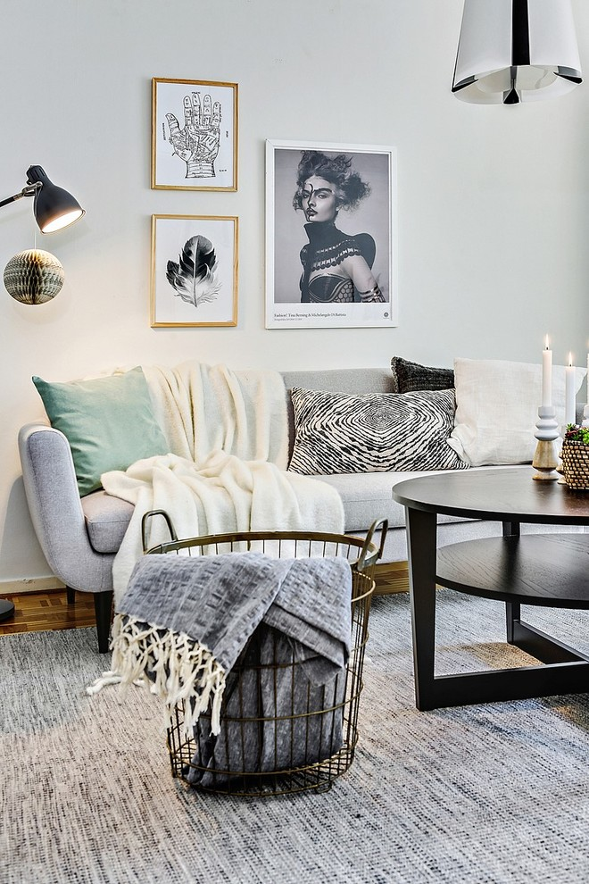 Mid-sized danish formal light wood floor living room photo in Gothenburg with gray walls