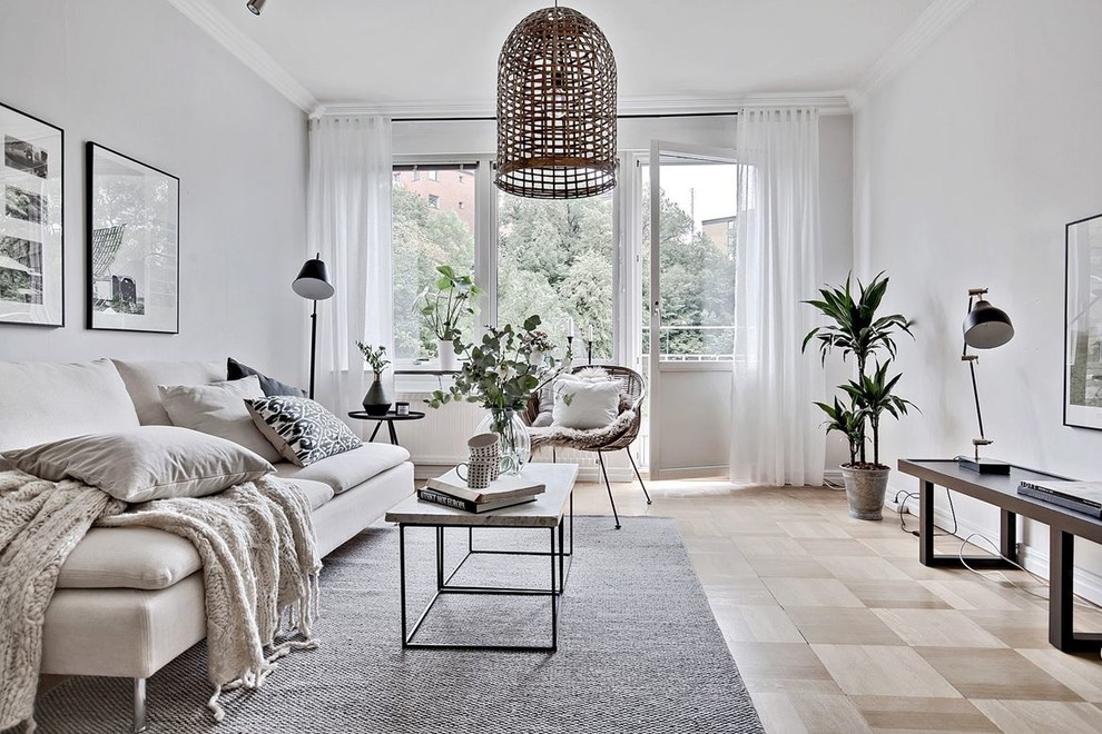 Living room - mid-sized scandinavian formal light wood floor living room idea in Gothenburg with gray walls and no tv