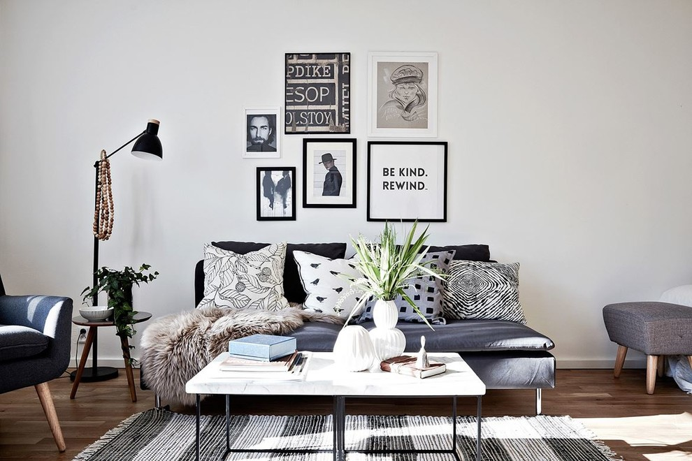 Mid-sized danish formal and enclosed light wood floor living room photo in Gothenburg with white walls and no tv