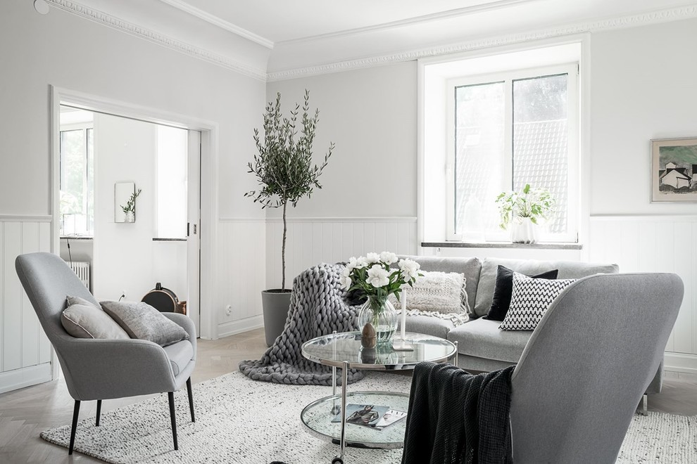 Living room - mid-sized scandinavian light wood floor and beige floor living room idea in Gothenburg with white walls