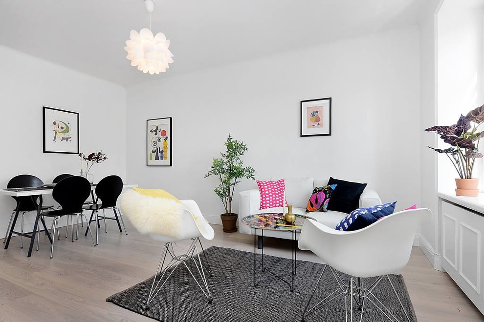 Mid-sized danish open concept and formal light wood floor living room photo in Stockholm with white walls and no tv
