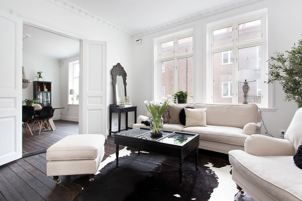 Example of a large danish formal and open concept dark wood floor living room design in Malmo with white walls, no fireplace and no tv