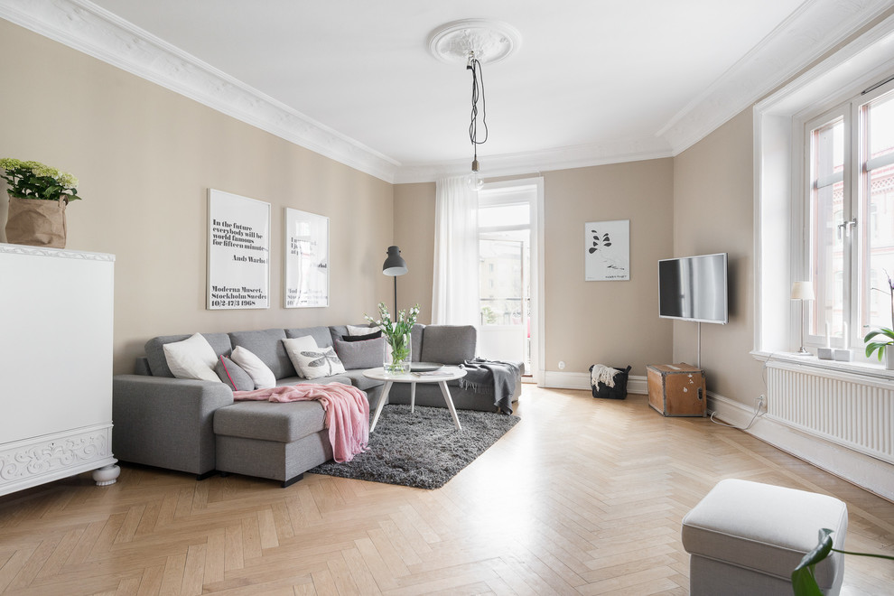 Living room - mid-sized scandinavian beige floor and light wood floor living room idea in Gothenburg with beige walls, no fireplace and a wall-mounted tv