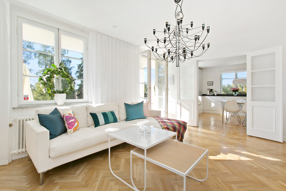 Large minimalist formal and open concept medium tone wood floor living room photo in Stockholm with white walls, no fireplace and no tv