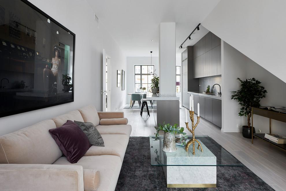 Living room - scandinavian open concept gray floor living room idea in Stockholm with white walls