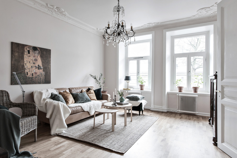 Inspiration for a large scandinavian enclosed light wood floor and beige floor living room remodel in Gothenburg with white walls